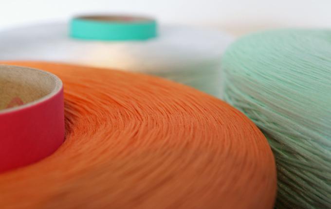 carpet yarns orange, green and clear
